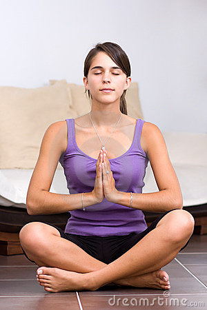 Pretty young woman meditating