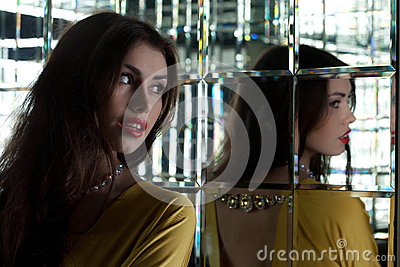 Pretty young woman near mirror
