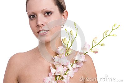 Pretty young woman portrait with orchid