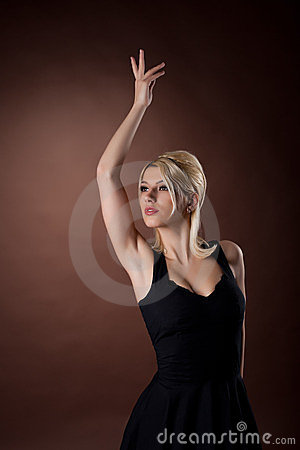Pretty young woman posing on brown background