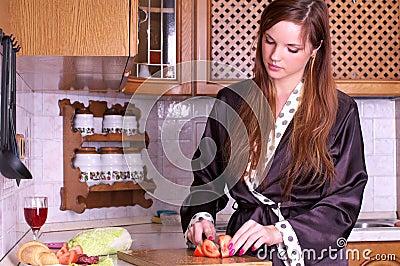 Pretty young woman preparing