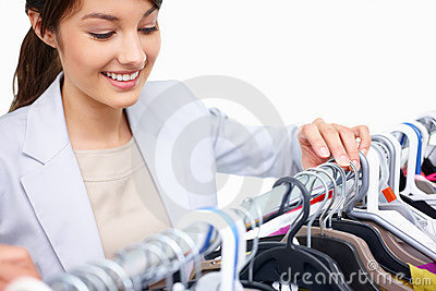 Pretty young woman purchasing clothes