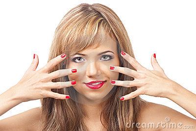 Pretty young woman with red lipstick and manicure