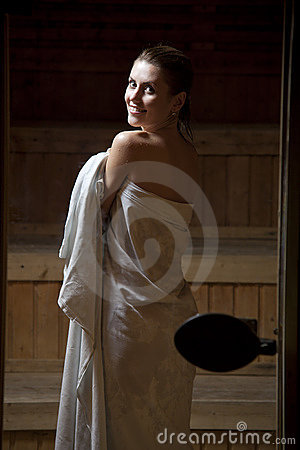 Pretty young woman in sauna