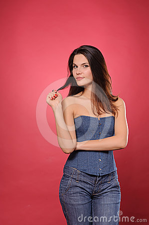Pretty young woman with slim waist in jean corset