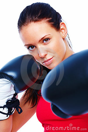 Pretty young woman smiling with boxing gloves