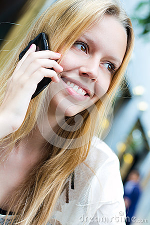 Pretty young woman talking on the smartphone