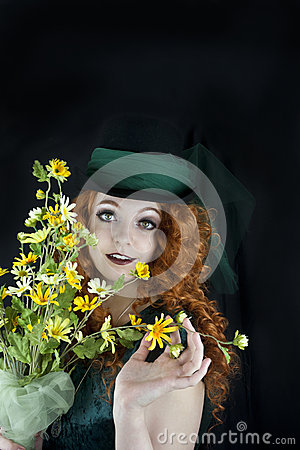 Pretty young woman in top hat