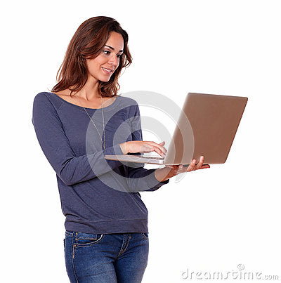 Pretty young woman working on laptop computer