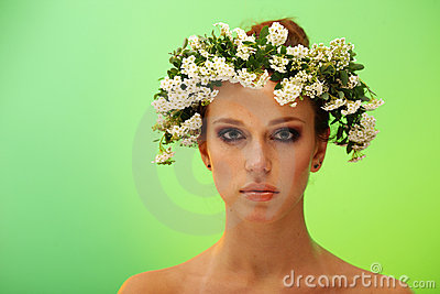 Pretty young woman with wreath on head