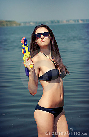 Pretty young women playing water gun