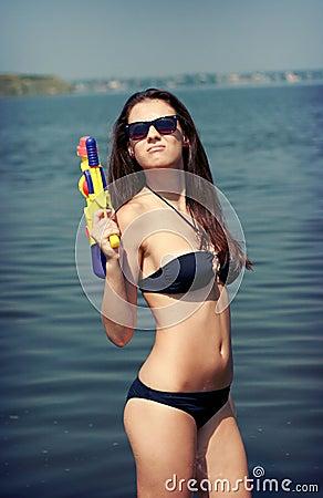 Pretty young women playing water gun