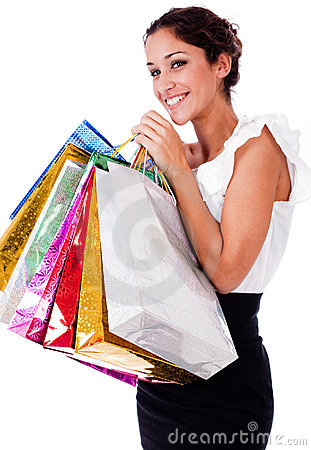 Pretty young women smiling with shopping bag
