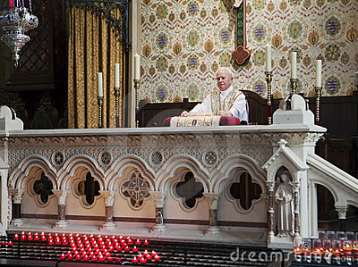 Priest At The Altar Editorial Stock Photo