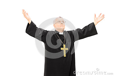 Priest in black mantle gesturing with hands