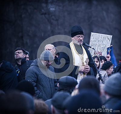 The priest blesses evromaydan activists in Ukrain Editorial Stock Image
