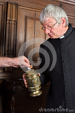 Priest collecting money