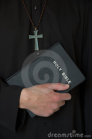 Priest, cross and bible