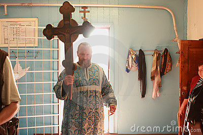 The priest enters the church Editorial Stock Photo