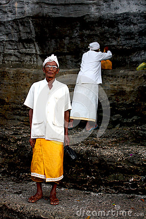 A priest and his assistant in Bali, Indonesia Editorial Stock Image