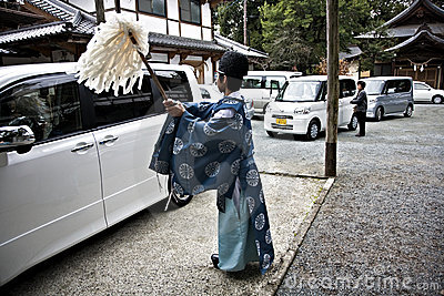 Priest purificating a car Editorial Image