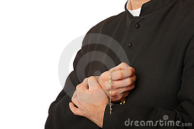 Priest s hands with rosary