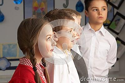 Primary Schoolchildren Standing In Classroom