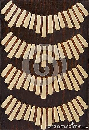 Primitive ethnic art brown ivory wood trivet
