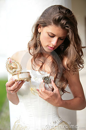 Princess with gift-brooch in hand