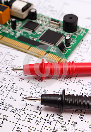 Free Printed Circuit Board And Cable Of Multimeter On Diagram Of Electronics Royalty Free Stock Image - 77486866