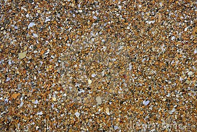 Priorità bassa bagnata del reticolo delle pietre della linea costiera