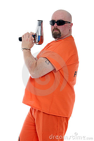 Prisoner holding a blow dryer