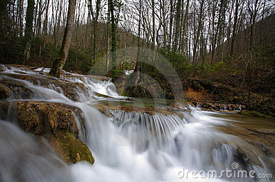 Pristine waterfalls in the forest in spring