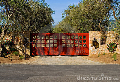 Private driveway with a big red gates