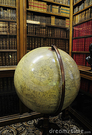 Private library with globe instrument
