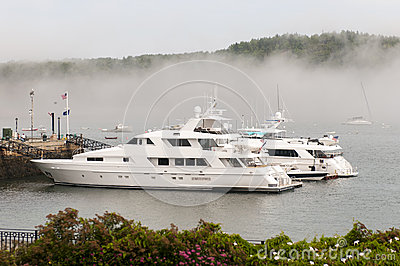 Private luxury yachts in fog