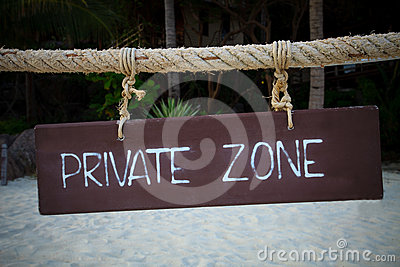 Private zone write on wood hanging rope at sea bea