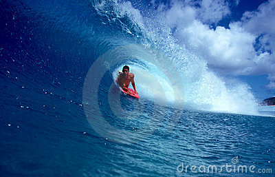 Pro Bodyboarder Alex Kinimaka in a Blue Tube Wave Editorial Photo