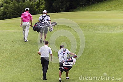 Pro carrelli dei giocatori di golf Immagine Stock Editoriale
