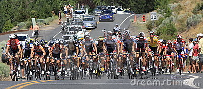 Pro Cycling Peloton charges up a climb panoram  Editorial Photography