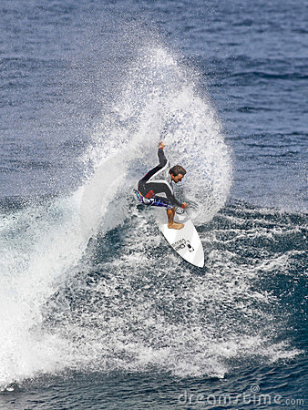 Pro Surfer Kalani Chapman surfing in Hawaii Editorial Stock Photo