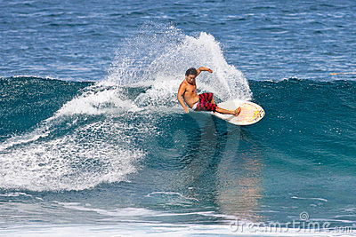 Pro Surfer Keoni Nozaki surfing in Hawaii Editorial Image