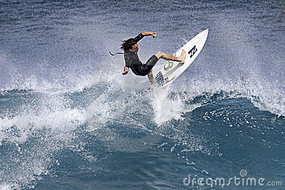 Pro Surfer Reubyn Ash surfing in Hawaii Editorial Image