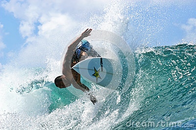 Pro Surfer Sunny Garcia surfing in Hawaii Editorial Stock Image