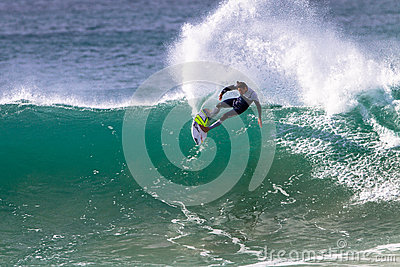Pro Surfer Surfing Rail Carve Editorial Stock Image