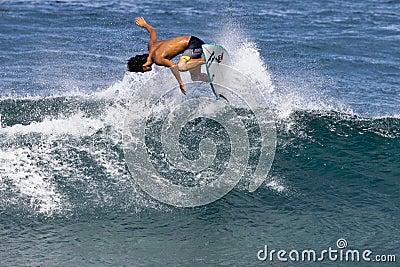 Pro Surfer Takumi Nakamura surfing in Hawaii Editorial Photo