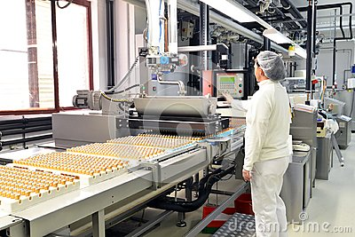 Production of pralines in a factory for the food industry - conv Stock Photo