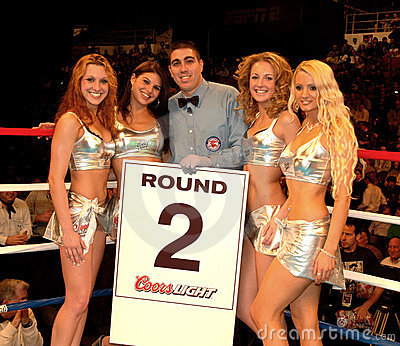 Professional Boxing referee with round card girls. Editorial Stock Image