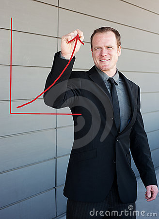 Professional businessman drawing a growth curve