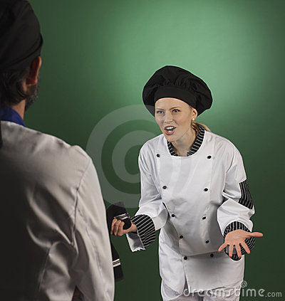 Professional cook scolding a cooworker